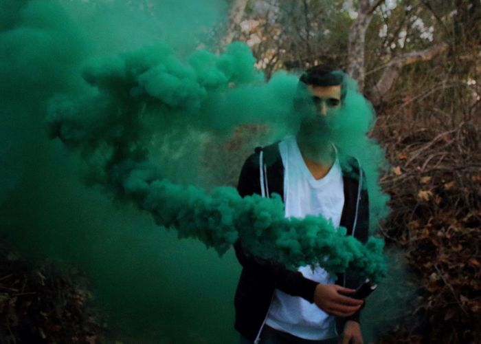 Playing with smoke 😍 Young Adult One Person Real People Lifestyles One Young Man Only Smoke - Physical Structure Men Standing Day Outdoors One Man Only Only Men People Adult Green Photography Model Canon Canonphotography Nature Smoke Bomb Green Color