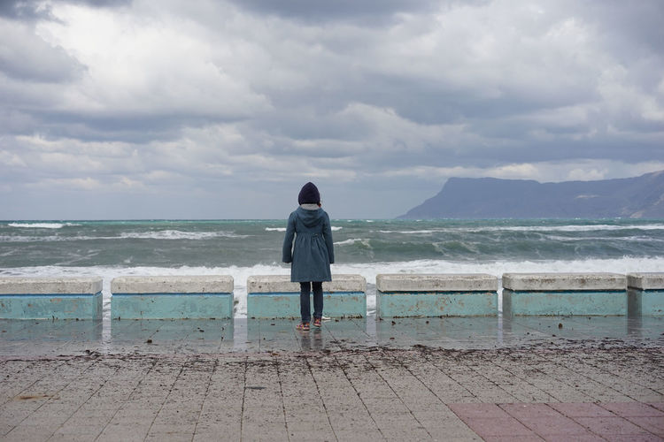 Watching the storm Beach Coastline Cold Crete Greece Escapism Getting Away From It All Girl Horizon Over Water Ocean Outdoors Pier Scenics Sea Seascape Shore Sky Storm Clouds Vacations Watching The Storm Water Waves Windy Day