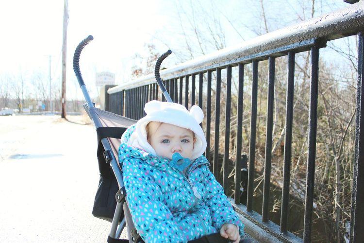 Portrait of baby girl on baby stroller