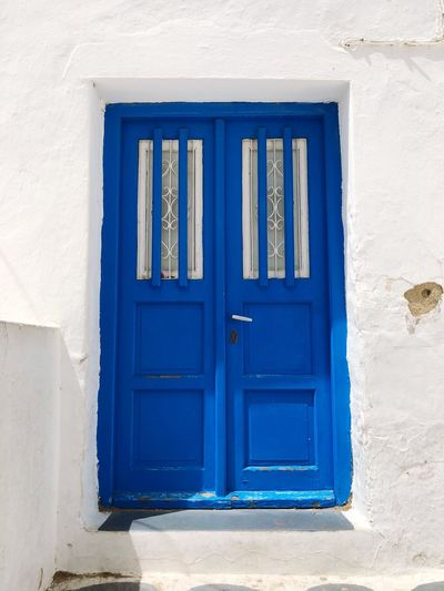 EyeEm Selects Blue Architecture Closed Door Built Structure Building Exterior Entrance Protection House No People Security Building Day Safety Wall - Building Feature Window White Color Front Door Residential District Old