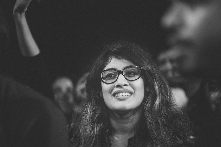 Close-Up Of Smiling Woman Wearing Eyeglasses Looking Away
