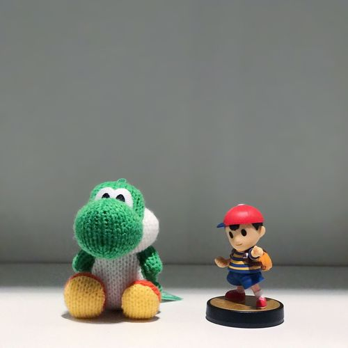 Toy Copy Space Studio Shot Cute Childhood Human Representation Figurine  Stuffed Toy No People Indoors  Green Color Close-up Ness Yoshi