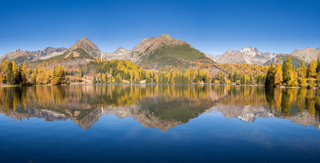 Strbske Pleso lake in the National Park of High Tatras National Park Panorama Panoramic Strbske Pleso Vysoke Tatry Blue Clear Sky Glacial High Tatras Lake Mountain Mountain Range Nature No People Outdoors Reflection Resort Scenics Tranquil Scene Autumn Autumn Colors Water Waterfront