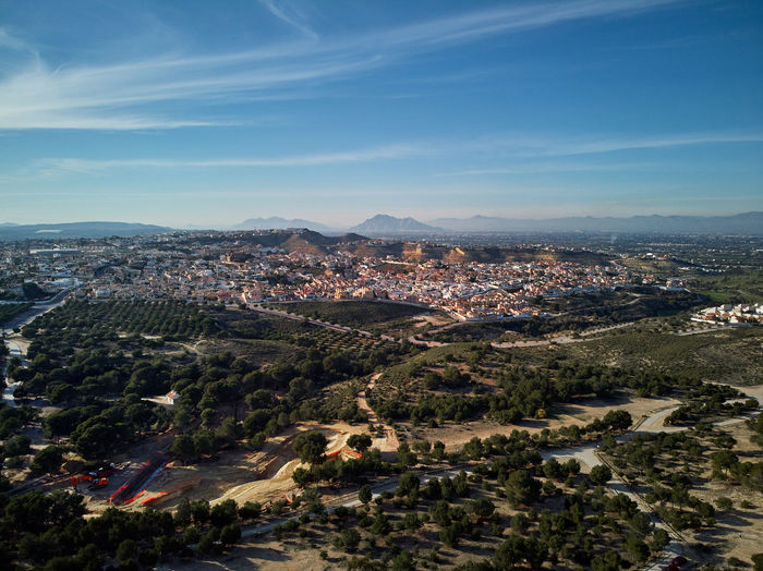 Aerial drone point of view photography countryside and Quesada district in the municipality of Rojales. Sunny day wide high angle landscape. Province of Alicante, Spain SPAIN Quesada Countryside Scenery Aerial View Aerial Aerial Photography Drone  Dronephotography Drone Photography Costa Blanca Panoramic Panorama Sky No People Cloud - Sky Landscape Scenics - Nature Mountain Hills Surroundings Sunlight Village Sunny Day Mountains