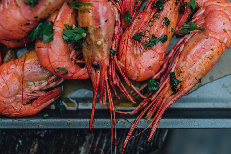 Spot prawns shrimp seafood in butter garlic parsley camping outdoors