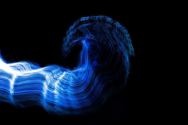 Abstract light painting against black background
