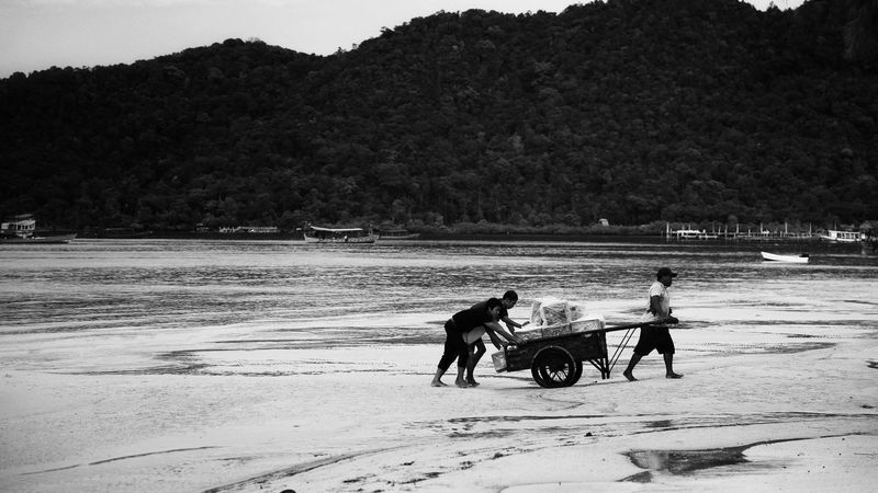 Beach Sand Transportation Sea Nature People Outdoors Water Men Togetherness Full Length Sihanouk Ville Province EyeEm Landscape EyeEm Selects 3XSPUnity EyeEm Gallery EyeEmNewHere EyeEm Best Shots EyeEmBestPics EyeEm Nature Lover EyeEm Best Shots - Nature Black And White Photography Lost In The Landscape