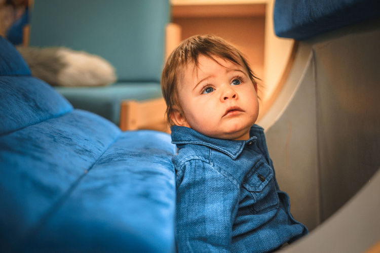 Babyboy Baby Baby Boy Babyhood Blue Casual Clothing Childhood Close-up Day Denim Home Interior Indoors  Lifestyles Looking Multi Colored Sitting