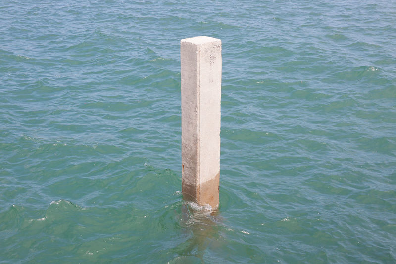 High angle view of wooden post in sea
