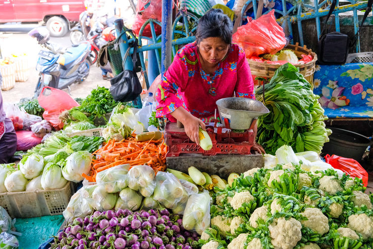 Various vegetables for sale at market stall