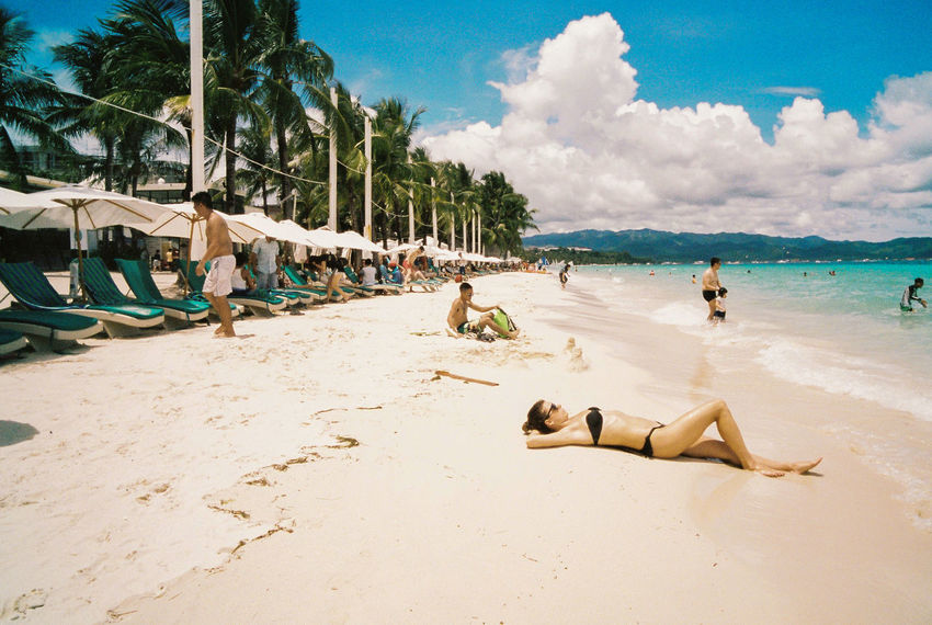 Boracay, Philippines Beach Sky Sand Cloud - Sky Outdoors Sea Day People Full Length Adult Nature Tree Boracay Philippines Film Film Photography Filmcamera Kodak Portra Leicam6 Sunbathing Filmphoto Breathing Space