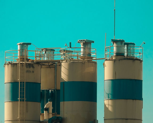 Blue Factory Industry Container Fuel And Power Generation Metal Clear Sky No People Sky Equipment Copy Space Side By Side Technology Industrial Equipment Built Structure Industrial Building  Nature Architecture Low Angle View Storage Tank Turquoise Colored