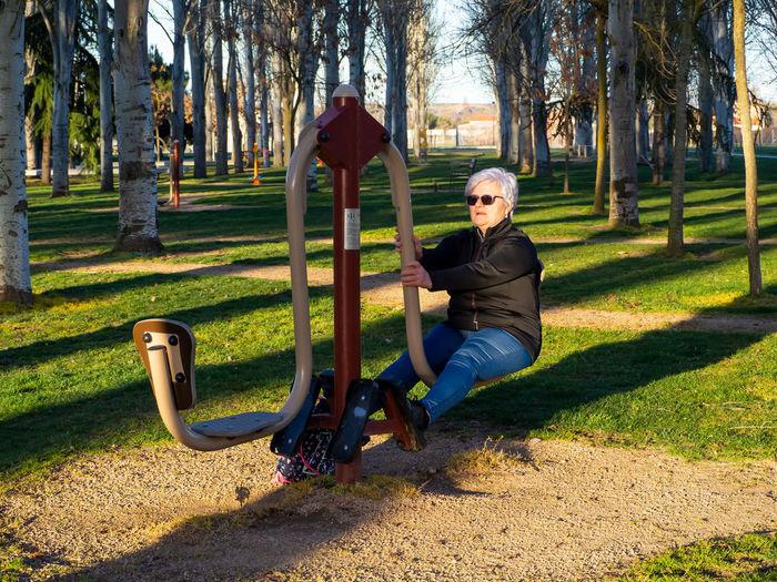 Portrait of woman sitting in park