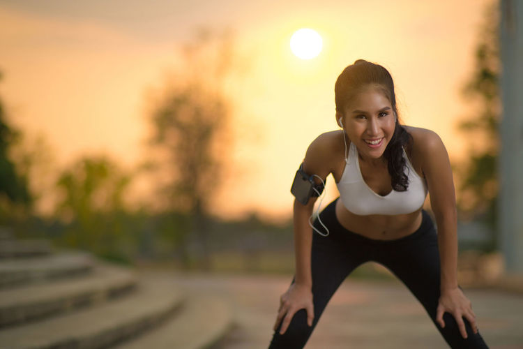 Adult Beautiful Woman Clothing Effort Exercising Focus On Foreground Front View Healthy Lifestyle Leisure Activity Lifestyles One Person Physical Activity Portrait Real People Sport Sports Clothing Sports Training Sunset Women Young Adult Young Women