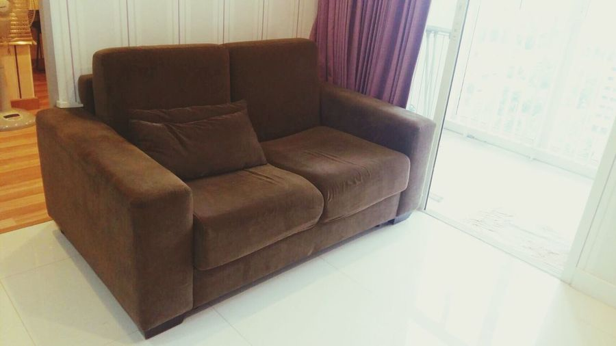 Condominium Two Seater Sofa sofa Modern Design No People, Indoors Living Room Modern Close Up brown color Clean bed room Height Angle Curtain Living Room Shot