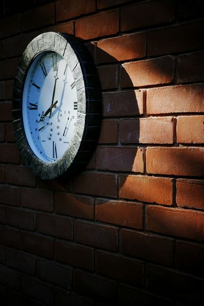 Early Morning Clock On The Wall Sunrise Brick Wall Shadow