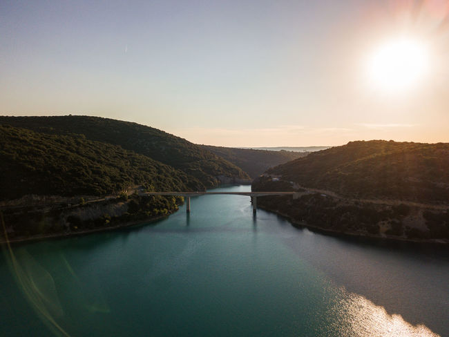 Lac de Sainte Croix, Gorges du Verdon and surroundings Drone  Verdon Beauty In Nature Clear Sky Day Drone Photography Dronephotography Droneshot Gorges Du Verdon Idyllic Lac Lake Lens Flare Mountain Nature No People Non-urban Scene Outdoors River Sainte Croix Sainte Croix Du Verdon Scenics - Nature Sky Sun Sunlight Tranquil Scene Tranquility Verdon Gorge Water Waterfront