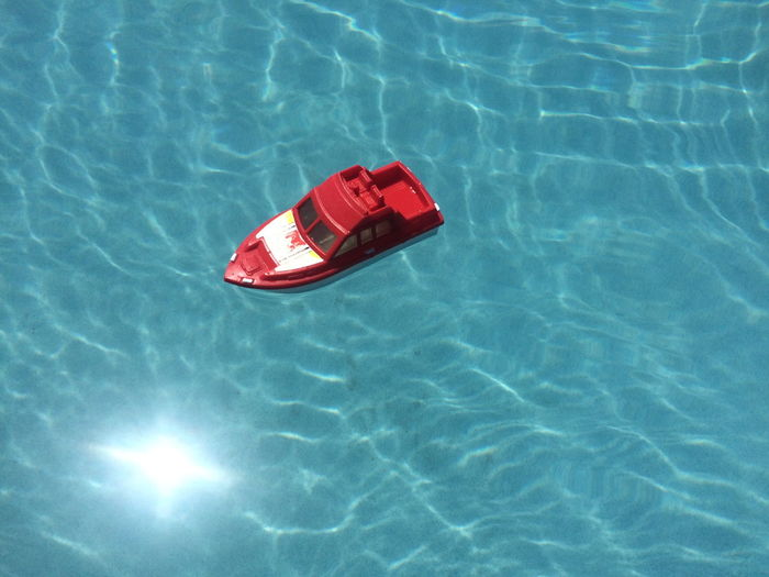 High Angle View Of Toy Floating On Swimming Pool