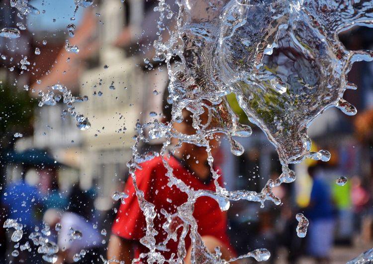 Close-Up Of Water Splashing At Fountain