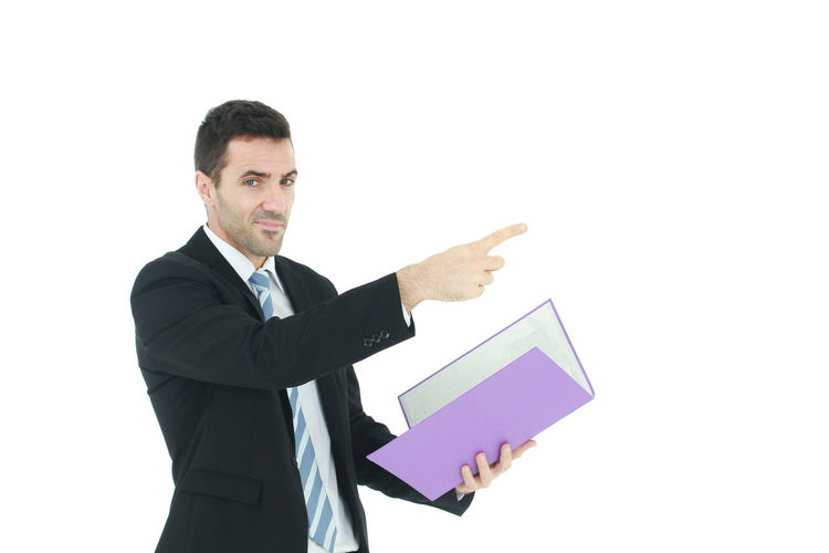 View of man holding flag against white background