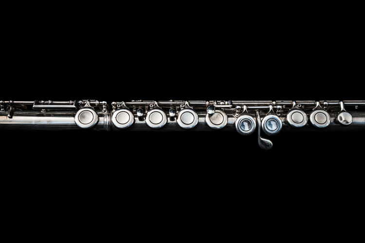 A transverse flute lying down. Music Shiny Black Background Close-up Cut Out Detailed Flute Illuminated Lying Down Metal Metallic Musical Equipment Musical Instrument No People Silver Colored Studio Shot Transverse Transverse Flute Wind Instrument