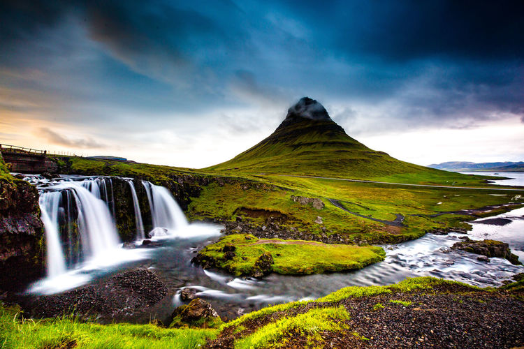@sgrobert / robertchai.com | A Little Sunny Light Out Breaking Out Of The Gloomy Skies At This Famous Landmark | Kirkjufellsfoss, Iceland Tranquil Scene Waterfall Nature Environment Cloud - Sky Beauty In Nature Water Scenics - Nature Colourful Sky Light Gloomy Long Exposure Mountain Kirkjufellsfoss Iceland Iceland_collection EyeEmNewHere EyeEm Best Shots EyeEm Nature Lover EyeEm Selects EyeEm Gallery Epic Shot Photography Best Shots EyeEm Tranquility Idyllic Green Color Power In Nature Stream - Flowing Water Outdoors Plant Flowing No People Non-urban Scene Land Landscape Flowing Water Motion