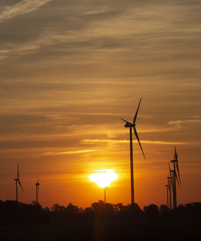 Sustainable sun rise scenery Renewable Energy Renewable Energy Wind Turbine Sustainable Resources Ecology Windmill Wind Turbine Wind Power Technology Serrated Power Station Power In Nature Sunset Rural Scene Electricity Pylon Romantic Sky Propeller Turbine Moody Sky Atmospheric Mood Industrial Windmill Scenics Cloudscape