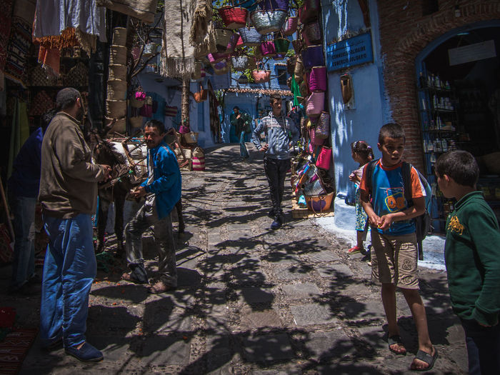 Street conversations Africa Blue Chefchaouen City Crowd Day Light Morocco Old Outdoors People Rare Real People Street Streetphotography Sun Town Travel White