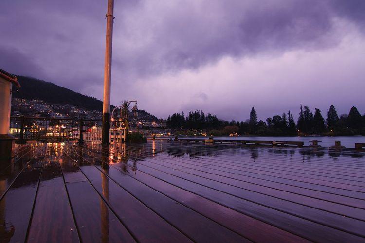 Wet Boardwalk Against Sky