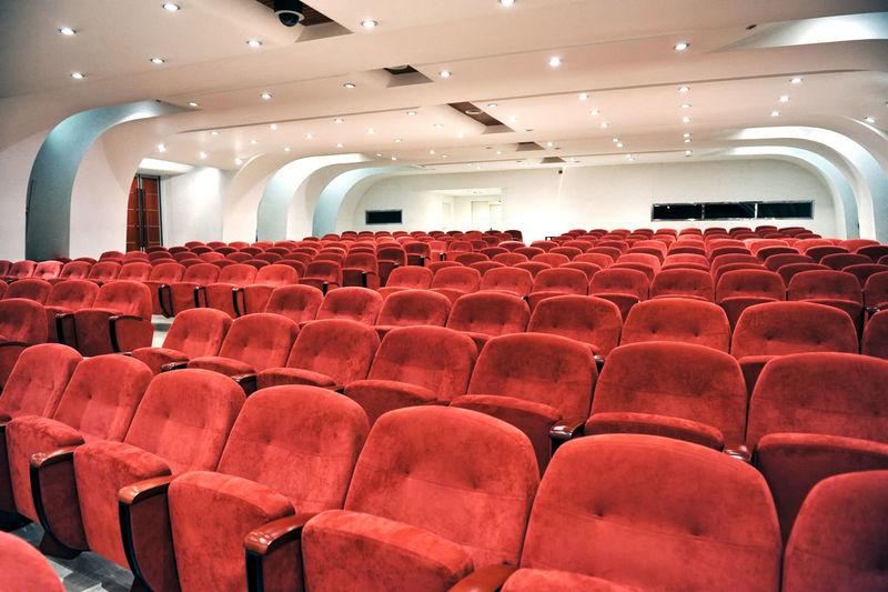 Empty red seats in auditorium