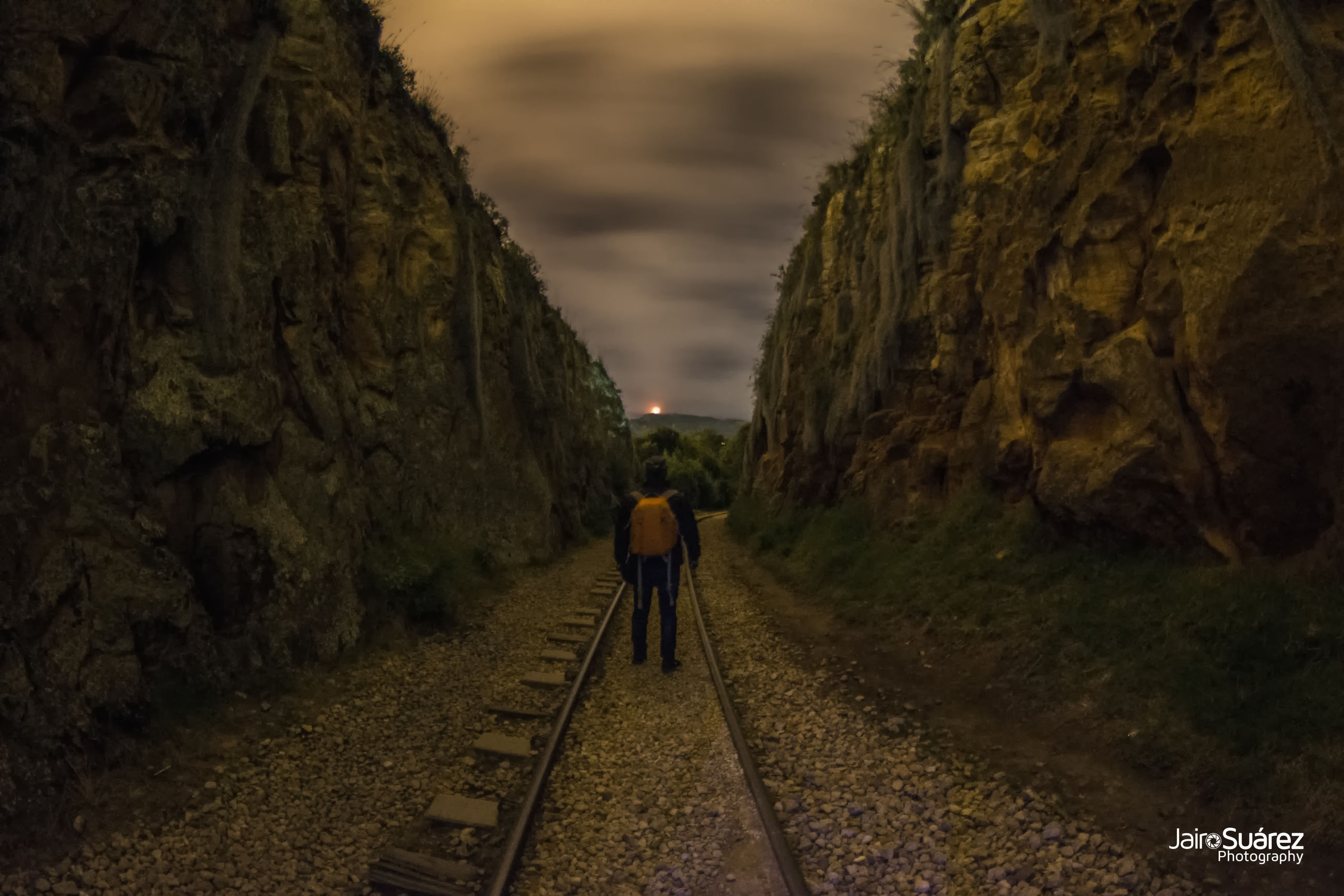 real people, transportation, direction, the way forward, rear view, one person, lifestyles, track, full length, railroad track, walking, rail transportation, nature, leisure activity, men, day, cloud - sky, outdoors, standing, diminishing perspective