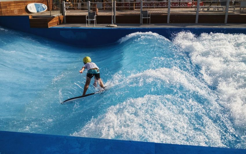 High angle view of boy surfing in swimming pool