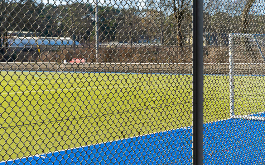 Fence Goal Soccer Soccer Field Focus On Foreground Sport Sport Field Chainlink Fence Day Barrier Boundary Safety No People Nature Security Outdoors Protection Seat Land Playing Field Empty Close-up Field Pattern