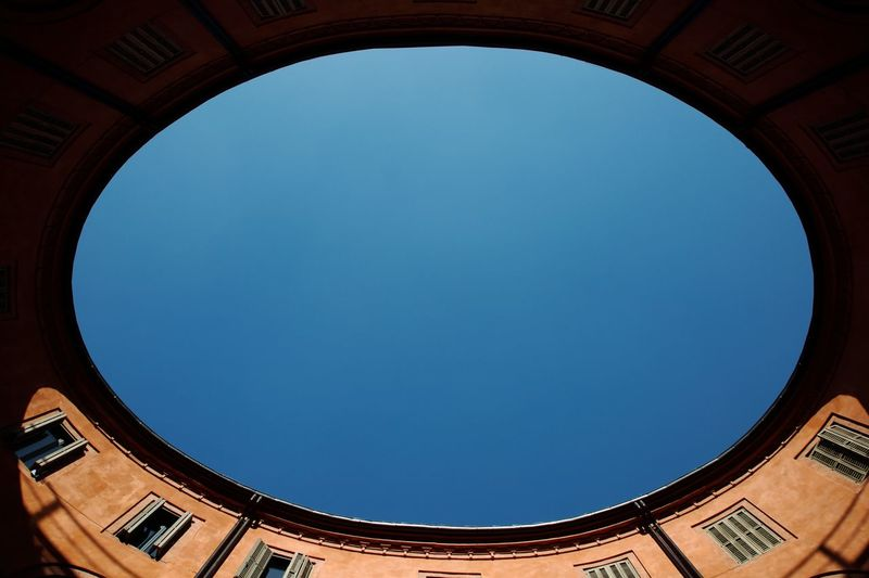 Il cielo dal cerchio Skyscraper City Cityscape Effect Detail Architecture_collection Old Buildings Destination Photography Bestoftheday EyeEmNewHere EyeEm Best Shots Italy Travel Old Canon5Dmk3 Architecture Built Structure Clear Sky Low Angle View Sky Geometric Shape Circle No People Building Exterior Outdoors Pattern Day Blue Shape 17.62°