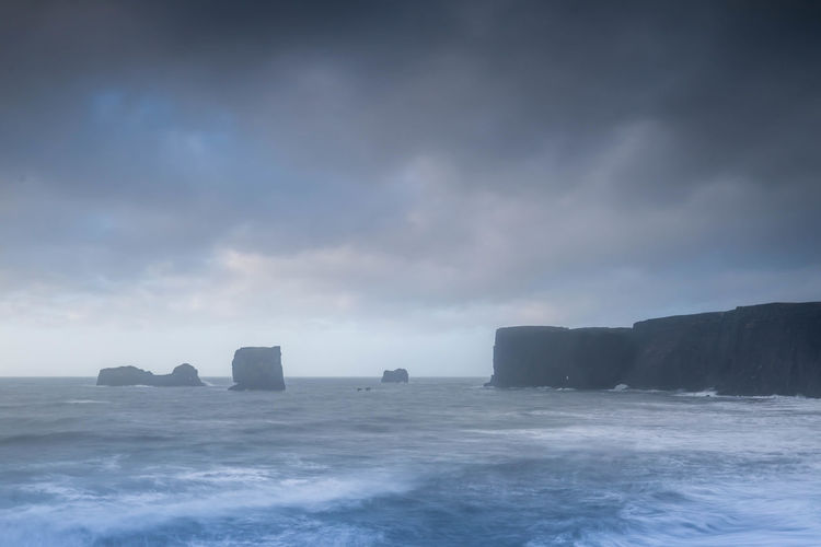 Beauty In Nature Cliff Cloud - Sky Cold Temperature Horizon Over Water Long Exposure Outdoors Sea Stacks Sea Stacks In Fog Winter