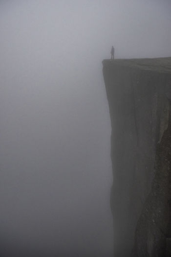 Shadow of person on cliff