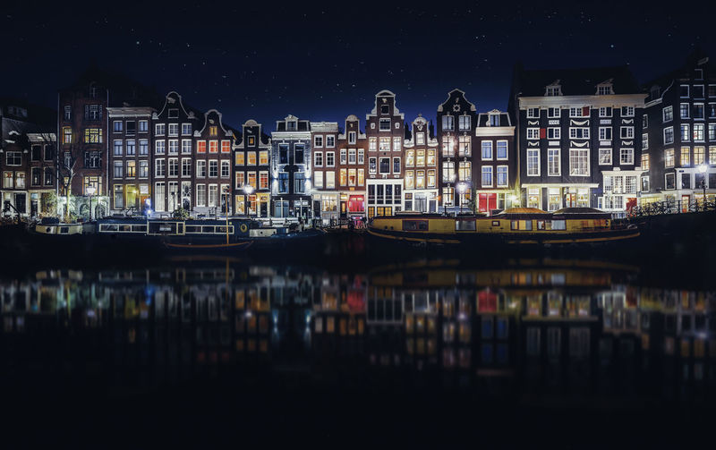 Amsterdam EyeEm Best Shots EyeEmNewHere Remo SCarfo Architecture Building Building Exterior Built Structure City Cityscape Dutch Illuminated Mode Of Transportation Moored Nature Nautical Vessel Night No People Outdoors Reflection Residential District River Transportation Water Waterfront