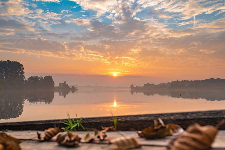 Sunset Beauty In Nature Water Nature Reflection Sky Orange Color Sun Scenics Tranquility Tranquil Scene Lake Outdoors No People Cloud - Sky Tree Day Nikon