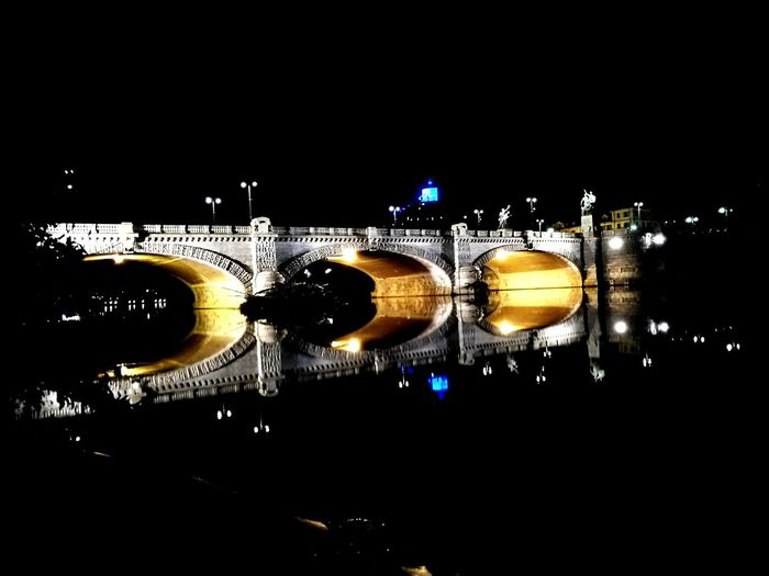 Illuminated Night Water Sky No People Outdoors Connection Bridge - Man Made Structure Architecture Star - Space City Torino EyeEm Gallery Eyemphotography EyemBest Shots Photograph Point Of View Around GAMMA PhonePhotography Huaweip9photos HuaweiP9 Photography Urban Flash
