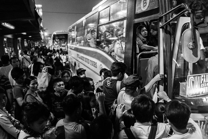 Commuters eager to go home on a Friday night rush hour fight their way on a jam packed bus along EDSA in Ortigas Center, Pasig City. 28 August 2016. Black And White Commuters Everybodystreet Street Photography The Human Condition The Photojournalist - 2016 EyeEm Awards Traffic Untold Stories MyCommute