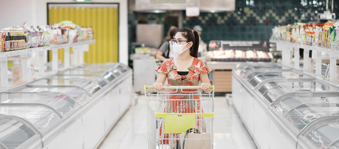Woman in market stall at store