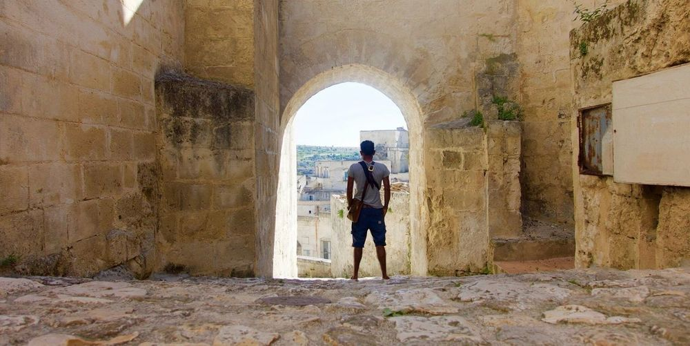 Built Structure Wall - Building Feature Architecture Real People Arch Full Length One Person Day Building Exterior Men Rear View Brick Wall Lifestyles Standing Outdoors Tunnel People SONYrx100m3 Traveling Matera Viaggiareinitalia EyeEmNewHere