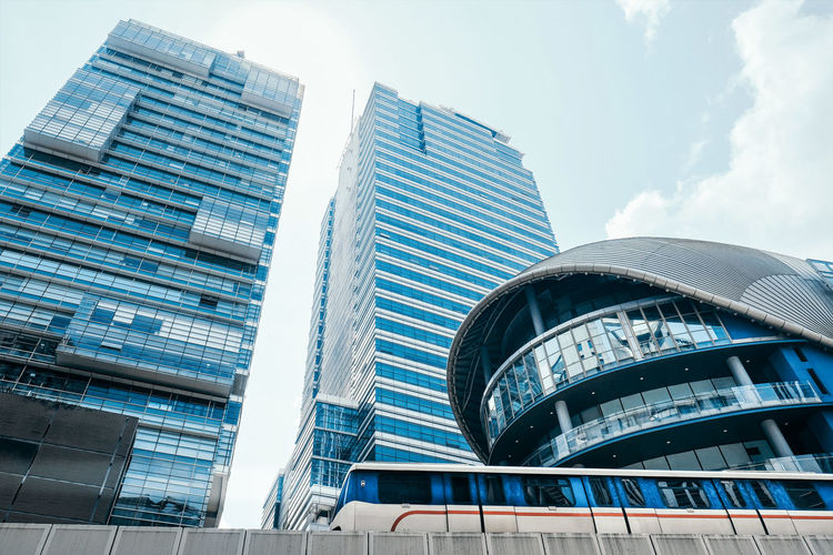 Building Exterior Built Structure Architecture Modern City Office Building Exterior Office Building Sky Low Angle View Glass - Material Tall - High Cloud - Sky Day Nature Skyscraper Tower No People Reflection Outdoors Financial District  Train Commuter Travel Economy Finance Development Infrastructure The Architect - 2019 EyeEm Awards