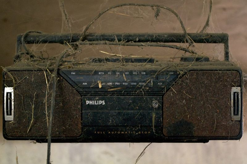 Web Radio Dirt Covered Hanging History Music No People Obsolete Old Stereo Radionation Spider Webs Tape Player Tapes Weathered Web Radio Long Goodbye
