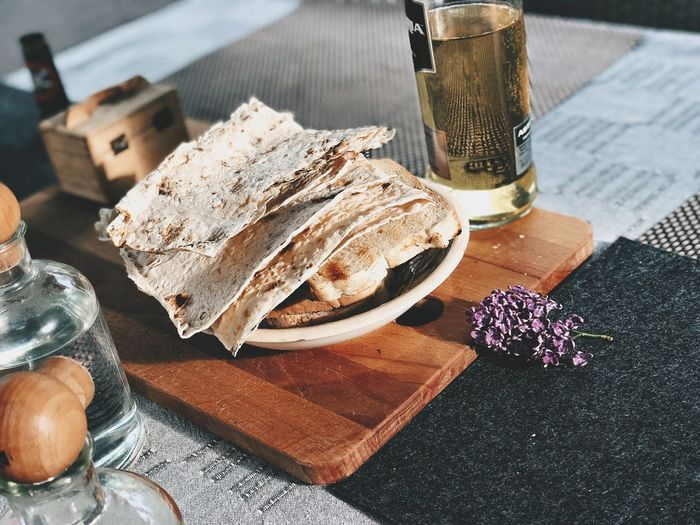 Leftover Light Golden Alcohol Lavash Lilac Table Food And Drink Freshness High Angle View Food Still Life Indoors  Close-up Flower Ready-to-eat Bread Plate Drink Wood - Material Day