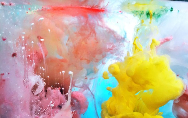 Close-up of colorful ink in water