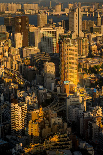 "Downtown Tokyo at sunset with its elevated ""Shuto"" highways Cityscape Japan Tokyo Aerial View Architecture Building Building Exterior Built Structure City City Life Cityscape Elevated Highway Financial District  Golden Hour High Angle View Landscape Modern No People Office Office Building Exterior Outdoors Residential District Skyscraper Tall - High Tower"