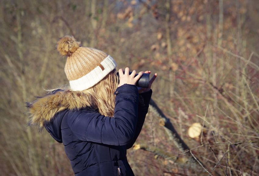 Observation Natural Landscape Binoculars Ornithology  Observation Outdoors Knit Hat Nature Lifestyles Blond Hair