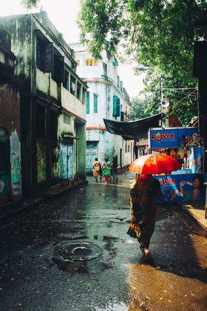 India Kolkata Streetphotography Rain Umbrella Illuminated Colours Colorful Journey Documentary Travel Photography Incredibleindia Eye4photography  Check This Out EyeEm Best Shots The Week On Eyem ASIA Street City Urban Cultures