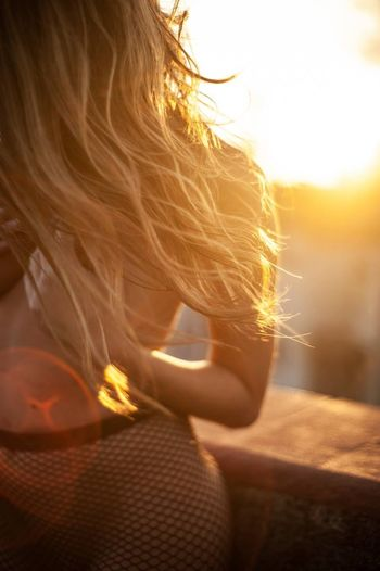 One Person Sunlight Hair Adult Women Lifestyles Human Body Part Real People Leisure Activity Sky Hairstyle Lens Flare Portrait Human Hair Sunset Nature Sun Headshot Close-up Young Women